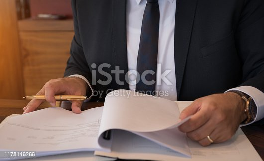 Caucasian lawyer signing documents in office