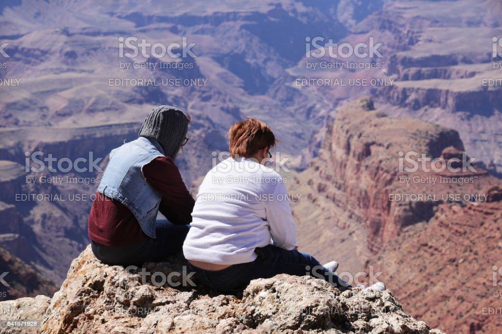 Caucasian Lesbian Tourist Couple Enjoying Grand Canyon stock photo
