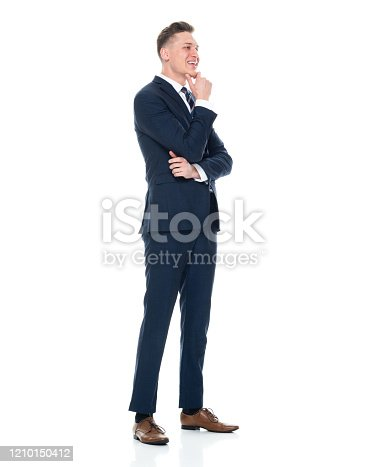 Profile view of aged 20-29 years old with brown hair caucasian male businessman standing in front of white background wearing businesswear who is uncertainty