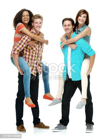Four people of who is tall person with curly hair caucasian male hipster standing in front of white background wearing button down shirt who is enjoyment