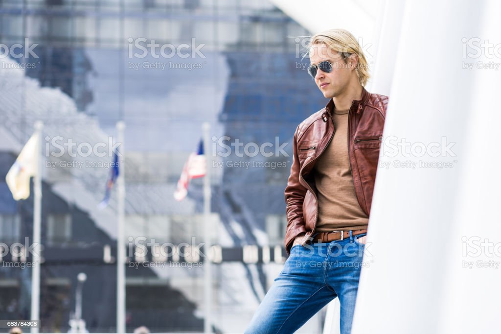 Caucasian Male In A Brown Leather Jacket and Blue Jeans stock photo