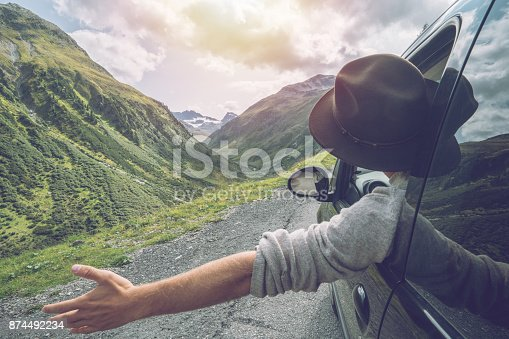 istock Caucasian male on road trip enjoying mountain landscape 874492234