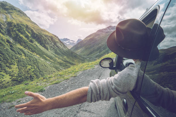 caucasian male on road trip enjoying mountain landscape - nature travel stock photos and pictures