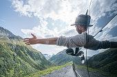 Caucasian male on road trip enjoying mountain landscape
