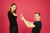 istock Caucasian male proposing to his asian girlfriend 904855500