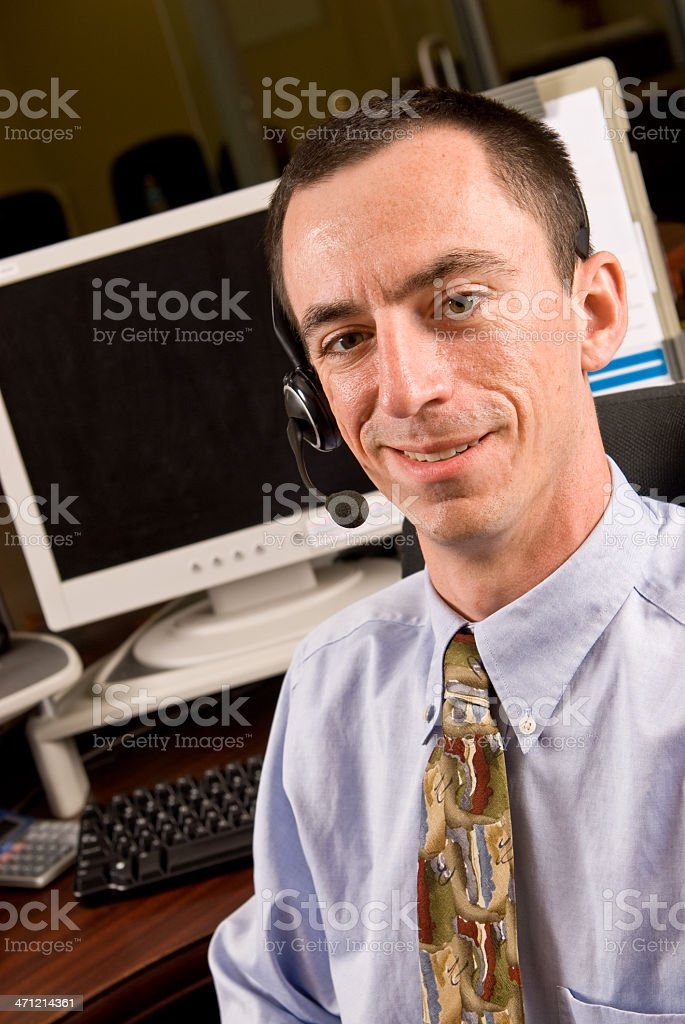 Caucasian Male Receptionist with Headset stock photo