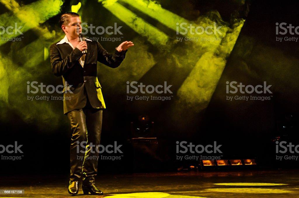 Caucasian male retro disco singer stock photo