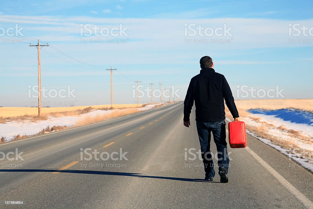 Caucasian Male Running Out of Gas on Highway stock photo