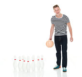 One person of aged 18-19 years old caucasian male standing in front of white background wearing shirt who is showing cool attitude and using sports ball