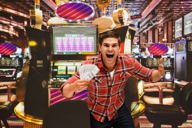 117 Handsome Man Playing The Slot Machine Stock Photos, Pictures &  Royalty-Free Images - iStock
