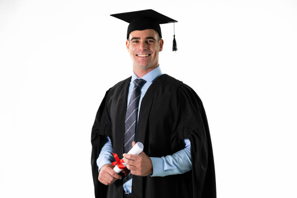 Caucasian male student holding a certificate graduating stock photo