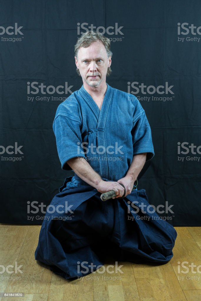 Caucasian male training Japanese sport iaido. royalty-free stock photo