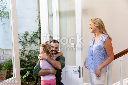 670900812 istock photo Caucasian man and his daughter embracing in the hallway 1253626386