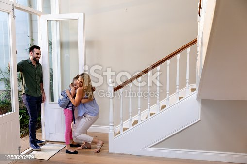 670900812 istock photo Caucasian man and his young daughter arriving home 1253626279