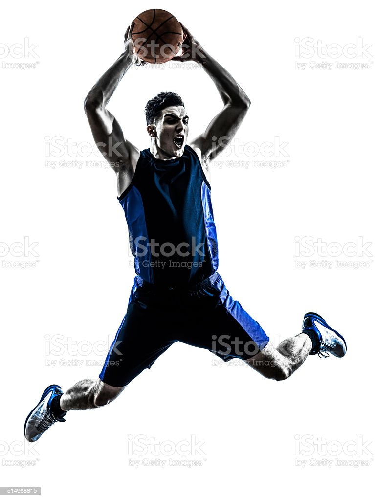 caucasian man basketball player jumping dunking silhouette stock photo