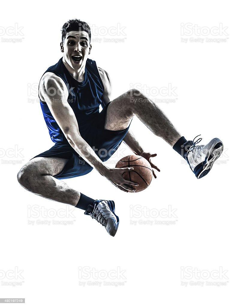 caucasian man basketball player jumping silhouette stock photo