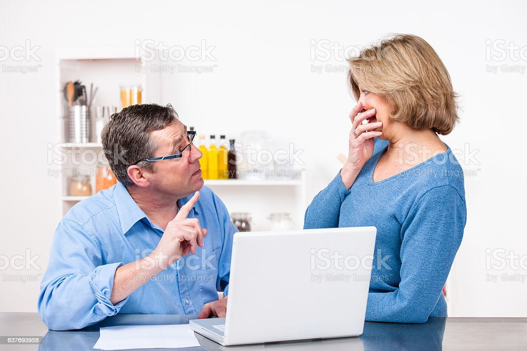 Caucasian Man Confronting His Partner About Overspending stock photo