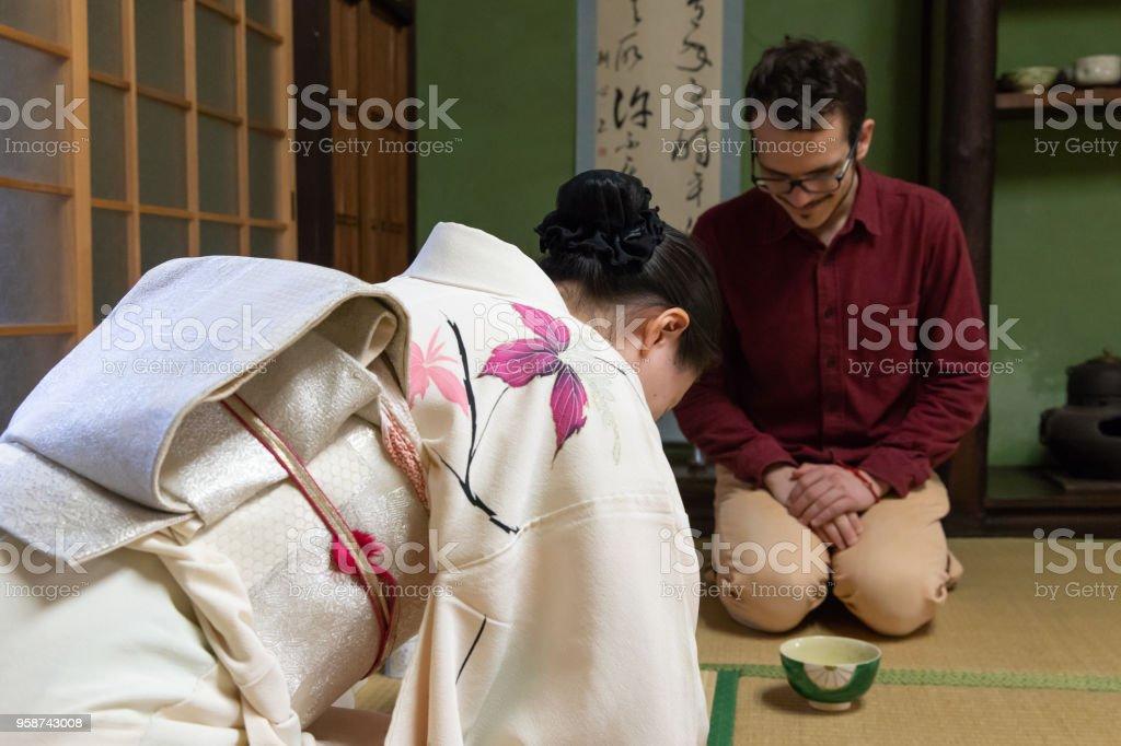 Caucasian man enjoy tea ceremony stock photo