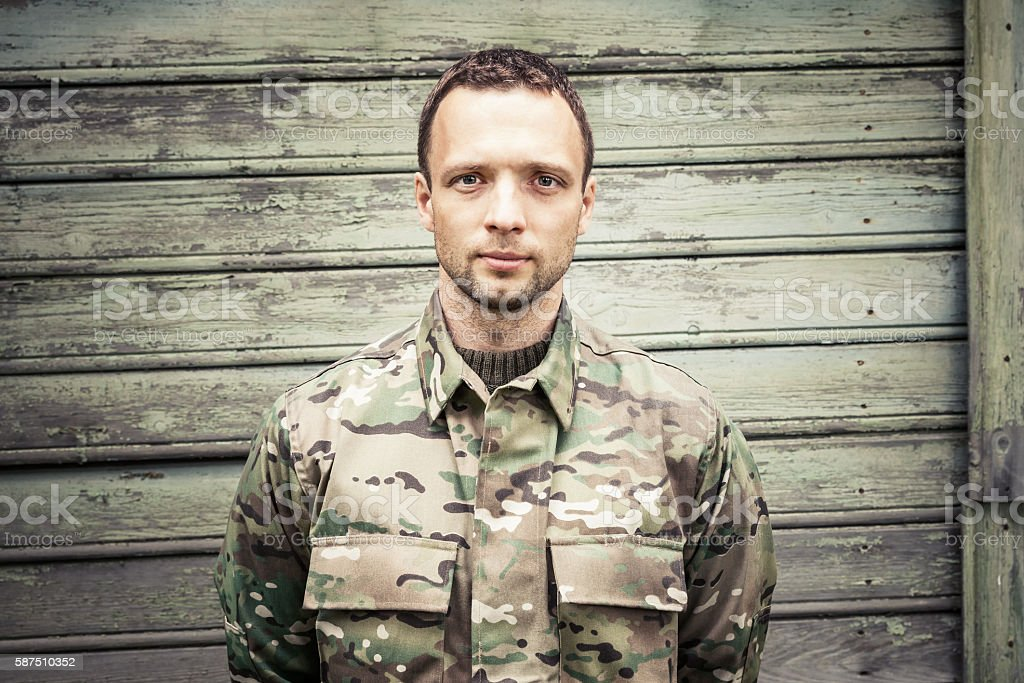 Caucasian man in camouflage uniform royalty-free stock photo
