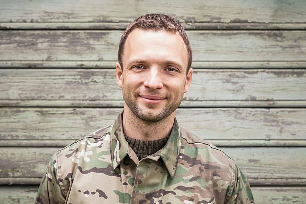 Caucasian man in military camouflage uniform stock photo