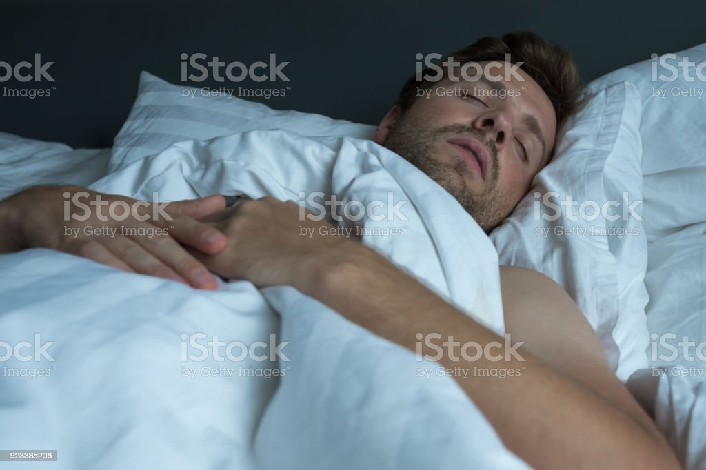 caucasian man napping with happy face expression. stock photo