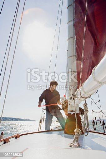 Caucasian man on sailboat