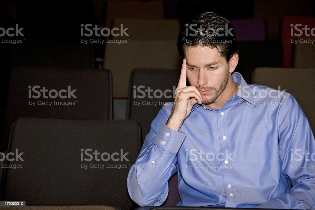 Caucasian Man Pondering Life While Sitting in Church Seat royalty-free stock photo