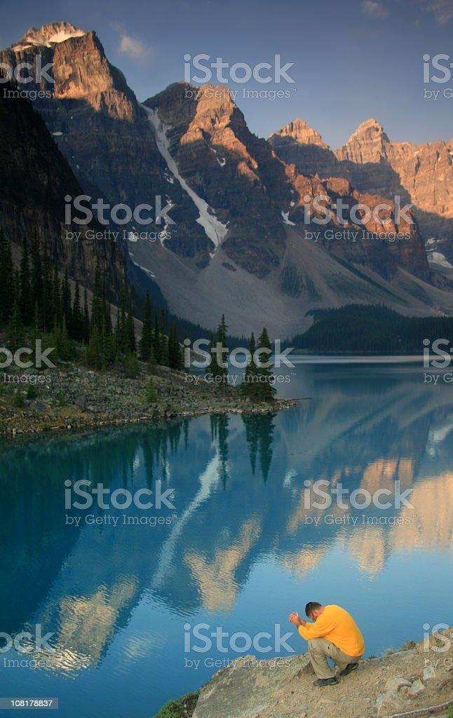 Caucasian Man Praying in the Mountains royalty-free stock photo