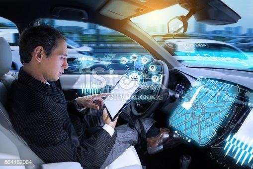 istock Caucasian man riding autonomous car. Self driving vehicle. Driverless car. 864462064