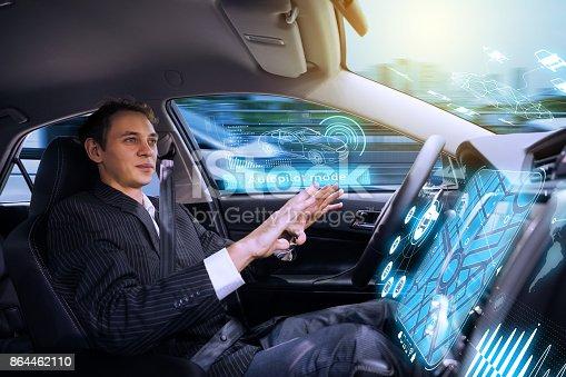 istock Caucasian man riding autonomous car. Self driving vehicle. Driverless car. 864462110