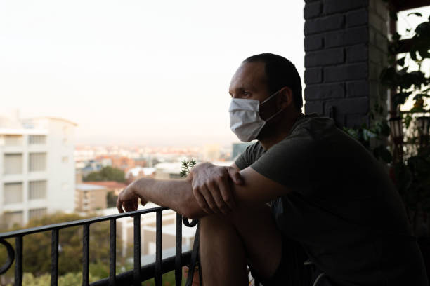 Caucasian man spending time at home self isolating and social distancing in quarantine lockdown duri stock photo