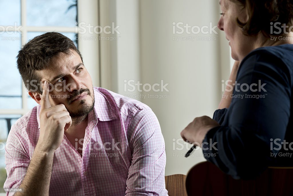 Caucasian Man Taking Part In a Counselling Session royalty-free stock photo