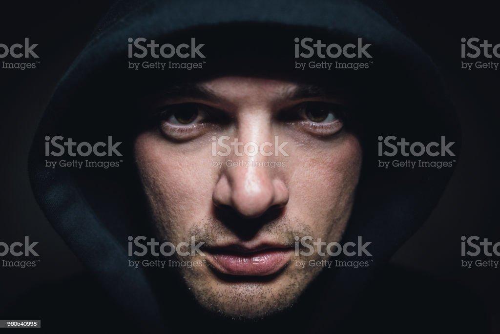 Caucasian man under the hoodie stock photo