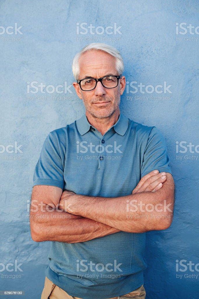 Caucasian man wearing glasses staring at camera stock photo