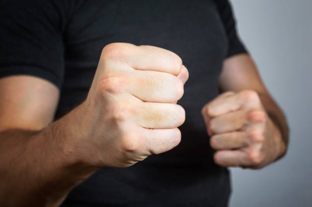 Caucasian man with a threatening gesture Caucasian man with a threatening gesture, ready to punch or fight with his fists threats stock pictures, royalty-free photos & images