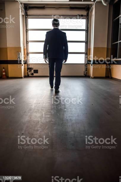 Caucasian middleaged male heading toward an exit picture id1203273829?b=1&k=6&m=1203273829&s=612x612&h=gamyp93c8o78lhte kc5pgkhwt0 nzkotppahursd48=