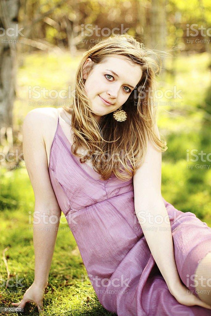 Caucasian Pink Dress Woman Sitting On Grass Portrait royalty-free stock photo
