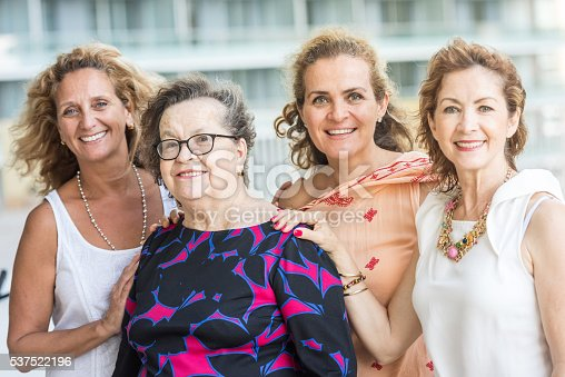Smiling Caucasian Senior mother posing with her mature daughters