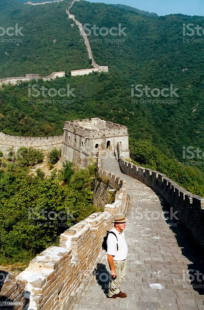 Caucasian senior tourist  standing on Great Wall of China,Beijing royalty-free stock photo