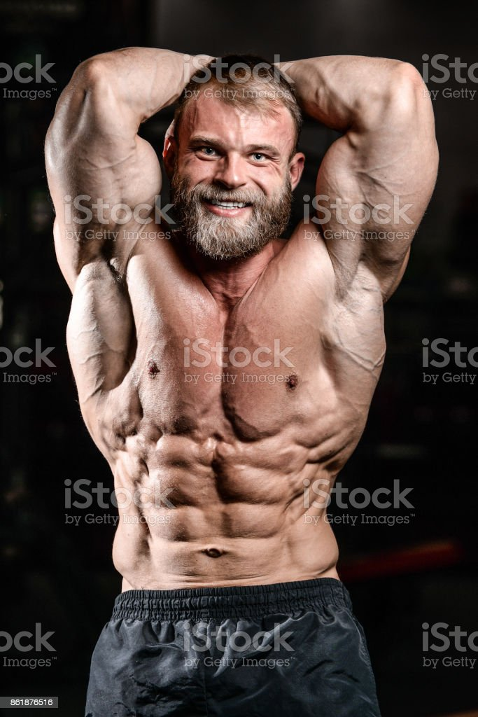 Caucasian Sexy Fitness Model In Gym Close Up Abs Stock Photo