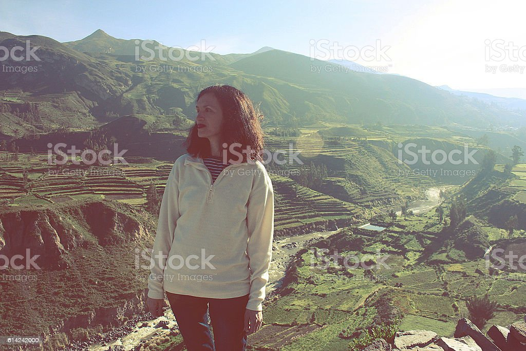 caucasian smiling skinny woman and Chivay View Outdoors, Peru stock photo