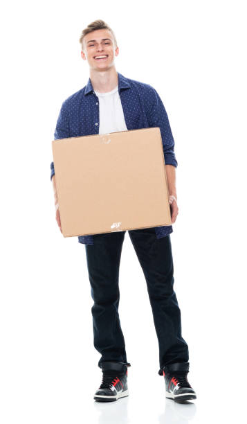 Caucasian teenage boys standing in front of white background wearing button down shirt and holding cardboard stock photo