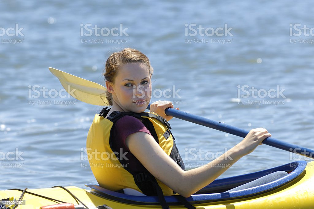 Caucasian Teenage Girl Kayaking on Body of Water royalty-free stock photo