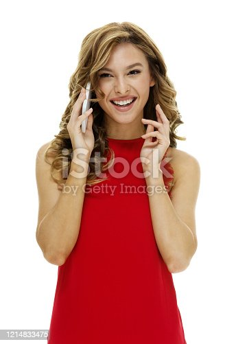 640046924 istock photo Caucasian teenage girls in front of white background wearing dress and using smart phone 1214833475