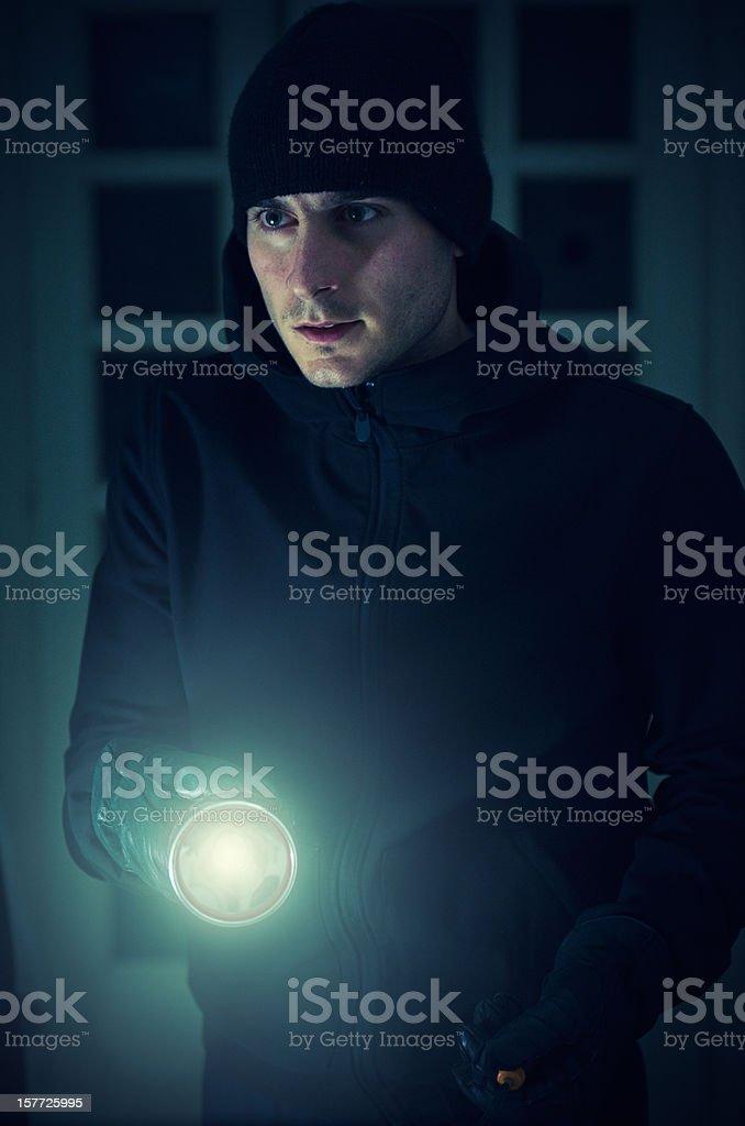 Caucasian thief with flashlight royalty-free stock photo