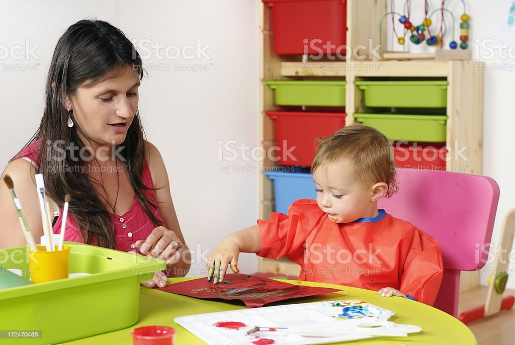 Caucasian Toddler Finger Painting Artwork With Carer stock photo