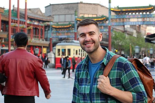 Caucasian tourist in Asian background.