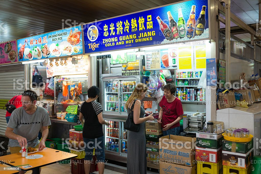 Caucasian Tourists Dining at Hawker Centre, Singapore stock photo