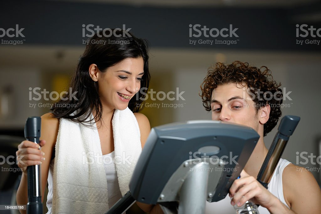 Caucasian Woman And Personal Trainer Reviewing Progress royalty-free stock photo