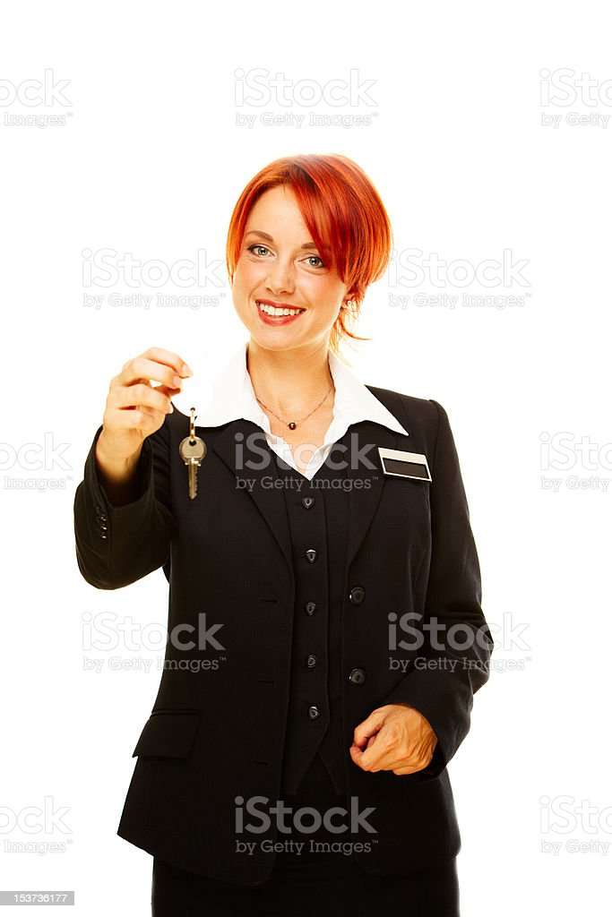 caucasian woman as hotel worker offering key stock photo